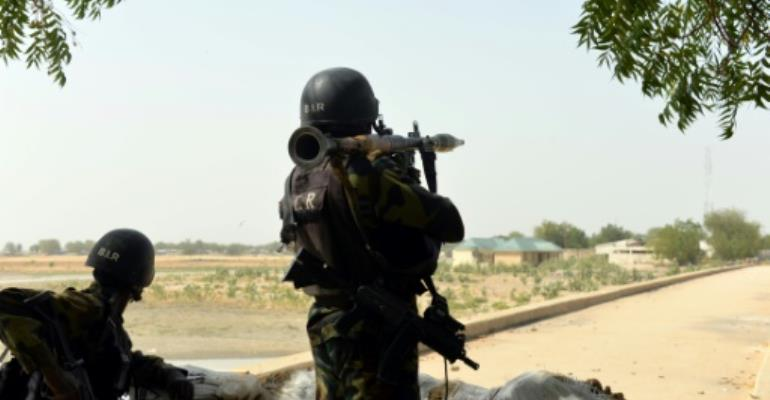 Cameroonian soldiers holding a position in the Cameroonian town of Fotokol, on the border with Nigeria on February 17, 2015.  By Reinnier Kaze (AFP/File)