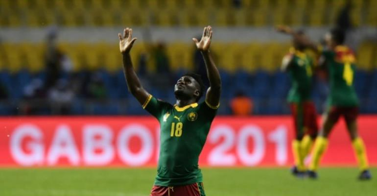 Cameroon's midfielder Robert Ndip Tambe celebrates at the end of their 2017 Africa Cup of Nations match against Guinea-Bissau at the Stade de l'Amitie Sino-Gabonaise in Libreville on January 18, 2017.  By GABRIEL BOUYS (AFP)