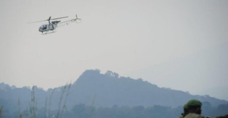 A UN helicopter flies near the village of Kibumba I, in DR Congo's restive North Kivu province on July 11, 2012.  By Phil Moore (AFP/File)