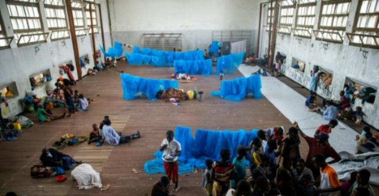 Cyclone survivors shelter in a school in Beira, Mozambique.  By WIKUS DE WET (AFP)