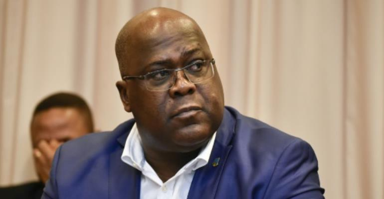 DR Congo President Felix Tshisekedi's party is in talks with supporters of ex-leader Joseph Kabila about the makeup of a new government.  By JOHN THYS (AFP/File)