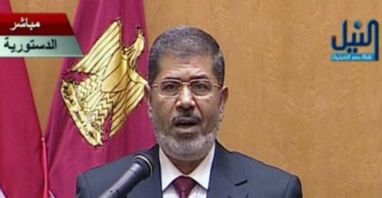 Mohamed Morsi wore a suit a burgundy tie for today's swearing in ceremony.  By  (AFP)