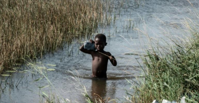 Experts have warned that the destruction of drinking water sources and lack of sanitation in overcrowded shelters in Mozambique could create breeding grounds for waterborne diseases such as cholera.  By Yasuyoshi CHIBA (AFP/File)