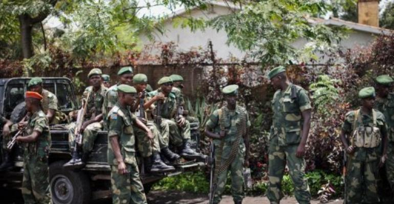 Soldiers of the Democratic Republic of Congo Armed Forces stand outside a general's residence in Goma.  By Phil Moore (AFP/File)