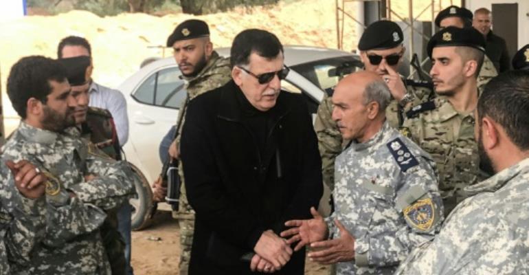 Fayez al-Sarraj (C) is head of Libya's Government of National Accord.  By Mahmud TURKIA (AFP)