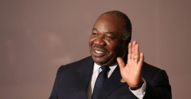 File picture of Ali Bongo, who fell ill with a stroke last October while visiting Saudi Arabia.  By MIKE HUTCHINGS (POOL/AFP/File)