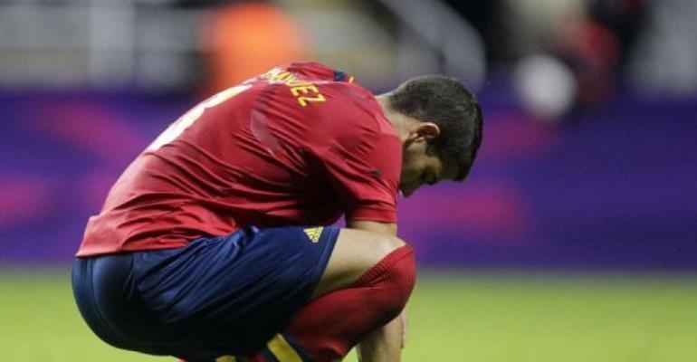 Spain's Alvaro Dominguez reacts after losing 1-0 to Honduras.  By Graham Stuart (AFP)