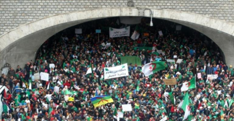 For the seventh Friday in a row huge crowds flood the streets of Algiers, the first protests since veteran leader Abdelaziz Bouteflika resigned.  By - (AFP)