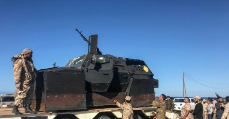 Forces loyal to Libya's UN-backed unity government have sent reinforcements to push back an advance on Tripoli by fighters of strongman Khalifa Haftar.  By Mahmud TURKIA (AFP)