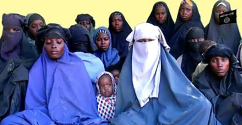 Fourteen missing 'Chibok girls' were seen in a video released on January 15 by their abductors.  By Handout (BOKO HARAM/AFP)
