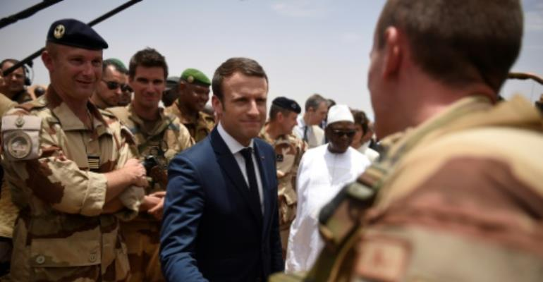 France's President Emmanuel Macron is visiting French troops in Mali on his first official trip outside Europe since taking power at the weekend.  By CHRISTOPHE PETIT TESSON (POOL/AFP)
