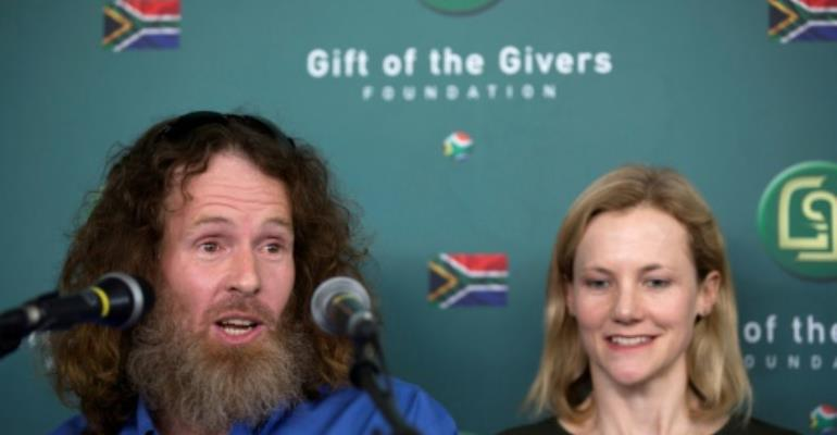 Freed South African Hostage Stephen McGown (L), who was held hostage by Al-Qaeda in Mali for nearly six years, alongside his wife Catherine (R) tells the medis he was well treated.  By GULSHAN KHAN (AFP)