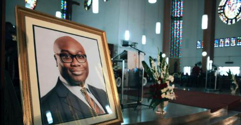 A portrait of BBC presenter Komla Dumor is set during his funeral on February 21, 2014, in Accra, Ghana.  By Chris Stein (AFP)