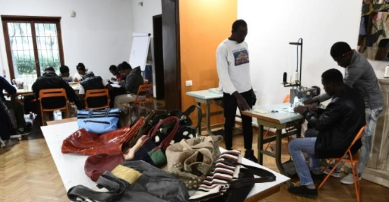 Handbags made by migrants at the Lai-Momo headquarters, a vocational training programme to teach skills in leather bag making to those seeking asylum in Italy..  By MIGUEL MEDINA (AFP)