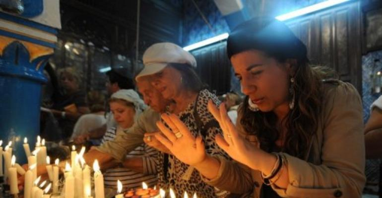 An Israeli woman prays in the Ghriba synagogue on the Tunisian island of Djerba in 2010.  By Fethi Belaid (AFP/File)