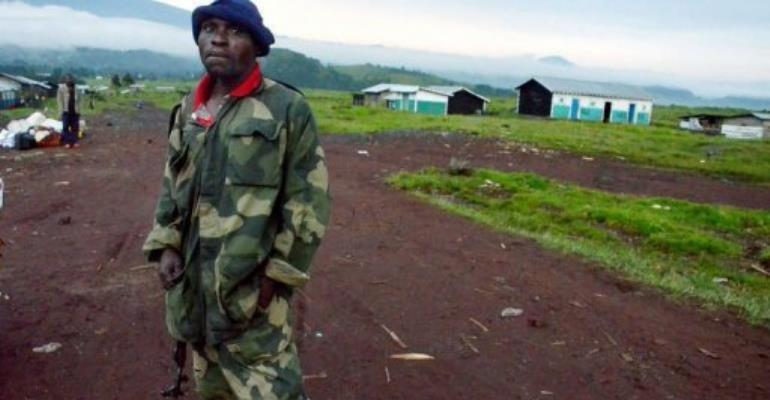 A Congolese army (FARDC) soldier stands on May 8, outside the deserted town of Kibumba.  By Junior D.Kannah (AFP/File)
