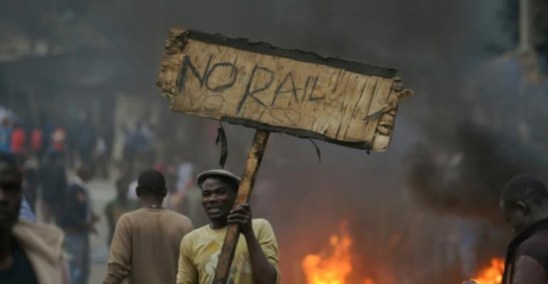 International observer missions called for calm and restraint in Kenya after isolated protests broke out following opposition leader Raila Odinga's rejection of early election results.  By TONY KARUMBA (AFP)