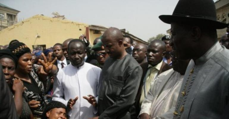 Nigerian President Goodluck Jonathan visits the church where  44 people were killed while leaving a mass.  By Wole Emmanuel. (AFP)