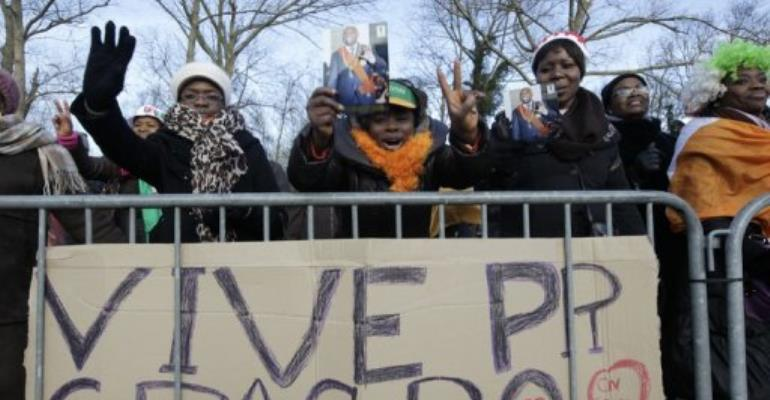 A pro-Gbagbo rally outside the International Criminal Court in The Hague.  By Anoek de Groot (AFP)