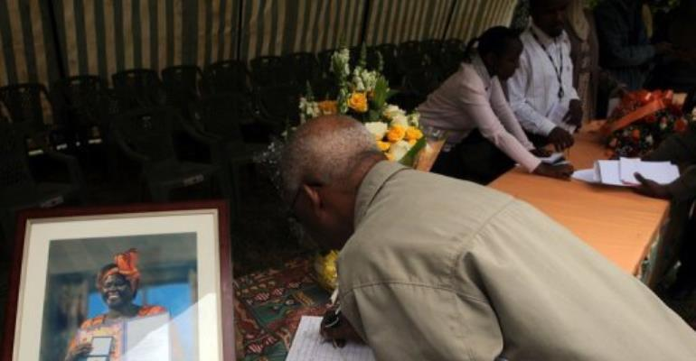 A Kenyan signs a condolence book for Wangari Maathai, who died of cancer on Sunday.  By Simon Maina (AFP)