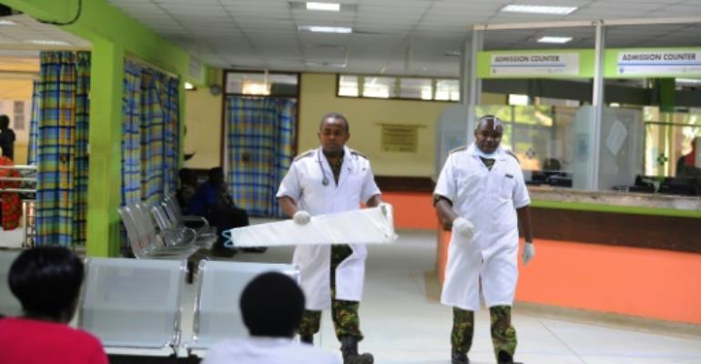 Kenyan Defence force doctors are seen inside Kenyatta National Hospital on December, 10,2016, in Nairobi.  By JOHN MUCHUCHA (AFP)