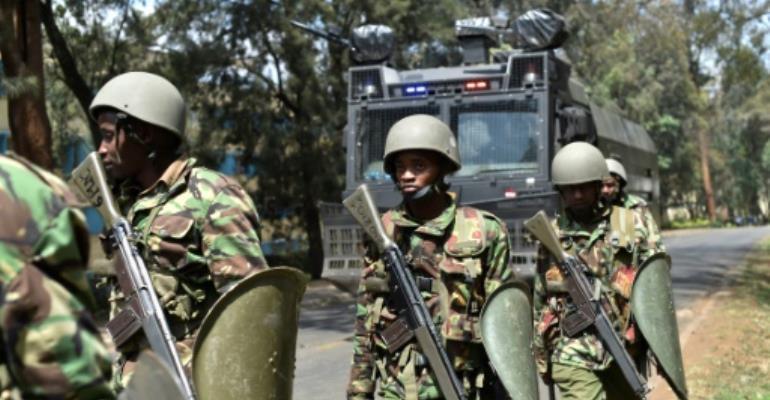 Kenyan riot police patrol a street after dispersing University of Nairobi students protesting in Nairobi on September 28, 2017.  By Simon MAINA (AFP/File)