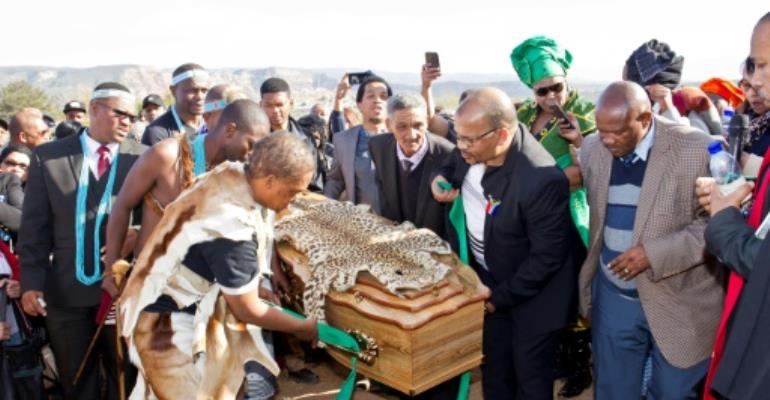 Khoi San community members in South Africa bury the