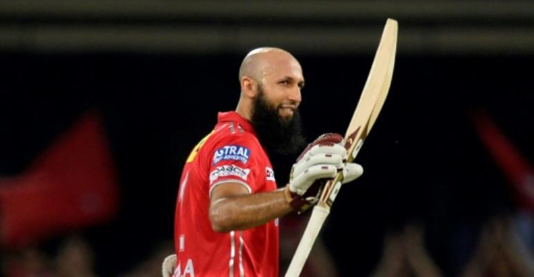 Kings XI Punjab's Hashim Amla celebrates his 60-ball 104 not-out in their match against Mumbai Indians.  By PUNIT PARANJPE (AFP)