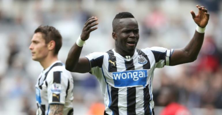 Late Ivory Coast midfielder Cheick Tiote (right) in action for Newcastle United in 2013.  By Ian MacNicol, Ian MacNicol (AFP/File)