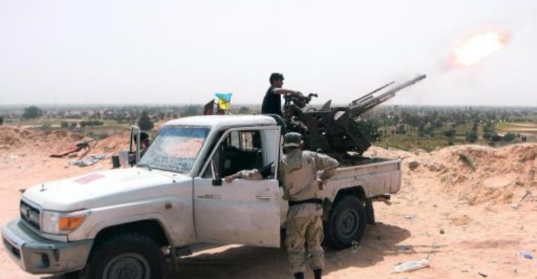A Zuwarah fighter fires an antiaircraft machine gun on April 4.  By Imed Lamloum (AFP/File)