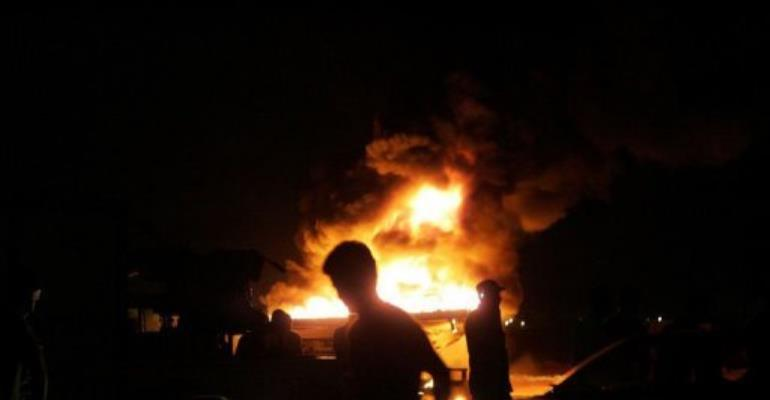 Vehicles burn after armed Libyan demonstrators stormed the headquarters of the Raf Allah al-Sahati Brigade.  By Abdullah Doma (AFP)