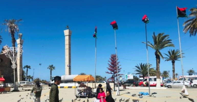 Libyans walk in the Tripoli's Martyr Square as fresh fighting flared south of the capital.  By Mahmud TURKIA (AFP)