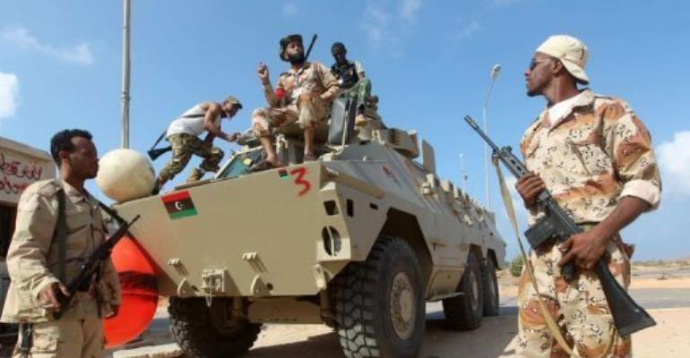 Libyan National Transitional Council (NTC) fighters are battling to reach the heart of Sirte.  By Ahmad al-Rubaye (AFP)