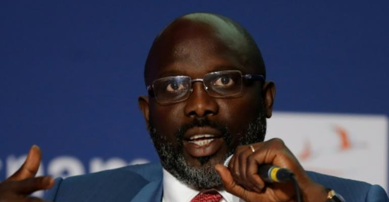 Liberian President George Weah spoke at a conference on education in Paris on the first day of his official visit to France..  By FRANCOIS GUILLOT (AFP)
