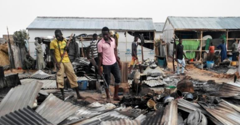 Local militia members played a key role in pushing out the Boko Haram Islamist militants from northeast Nigeria.  By - (AFP)
