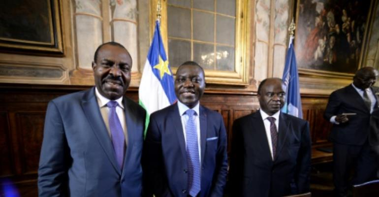 L-R: National Convergence Kwa Na Kwa party general secretary Bertin Bea, Republic of Central Africa foreign minister Charles Armel Doubaned and Central African president political advisor George Isidore Alphonse Dibert pose on June 19, 2017 in Rome.  By FILIPPO MONTEFORTE (AFP)