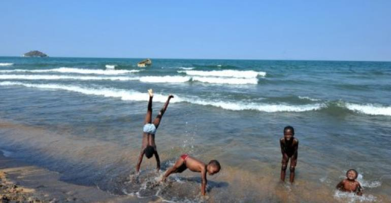 Children play along the Saga beach, at Lake Malawi, in 2011.  By Alexander Joe (AFP/File)