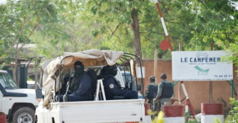 Malian police enter the Kangaba tourist resort just east of the capital Bamako a day after the assault which began on Sunday.  By Habibou KOUYATE (AFP)