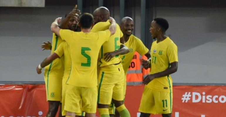 Members of the South African national football team celebrates a goal during the 2019 African Cup of Nations qualifyer football match against Nigeria at Goodswill Akpabio International Stadium on June 10, 2017.  By PIUS UTOMI EKPEI (AFP)