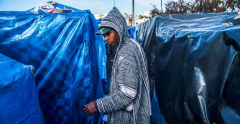 Migrants are left stranded in a makeshift camp in Morocco after failing in attempts to get to Europe.  By FADEL SENNA (AFP)