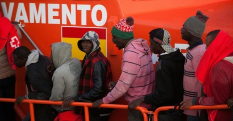 Migrants disembark from a coast guard boat after being rescued at sea off the coast of Spain, the one route last year that saw an increase in the number of illegal border crossings into the EU..  By JORGE GUERRERO (AFP)