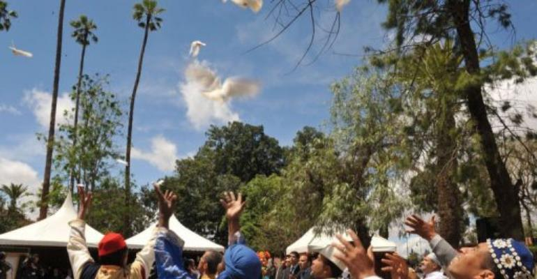 Moroccans relsease doves during a ceremony.  By Abdelhak Senna (AFP)