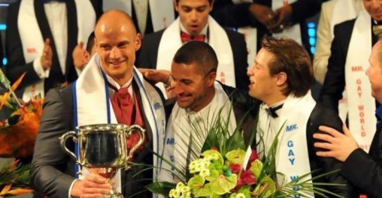 Andreas Derleth (L), a German who lives in New Zealand, took the Mr Gay World title late Sunday.  By Alexander Joe (AFP)