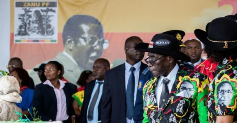 Mugabe celebrated last year with a huge birthday cake and a lavish party.  By Jekesai NJIKIZANA (AFP/File)