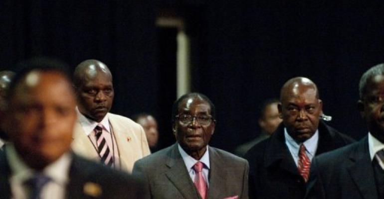 Zimbabwean President  Robert Mugabe (C) attends a Southern African Development Community (SADC) Extraordinary Summit.  By Alexander Joe (AFP/File)