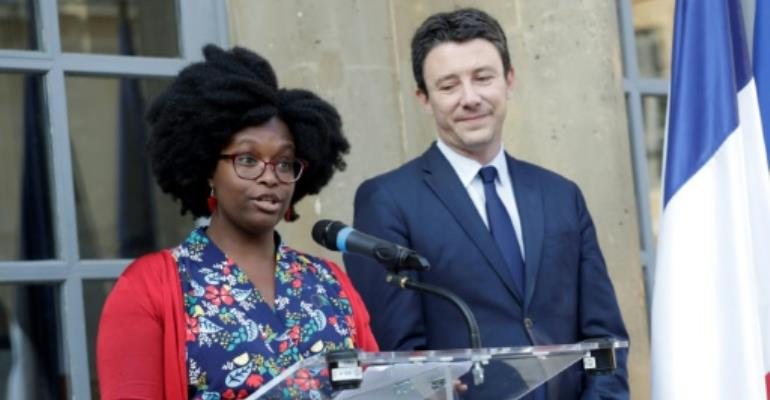 Newly appointed French government spokesperson Sibeth Ndiaye, left, and her predecessor Benjamin Griveaux at a handover ceremony in Paris on Monday.  By Thomas SAMSON (AFP)