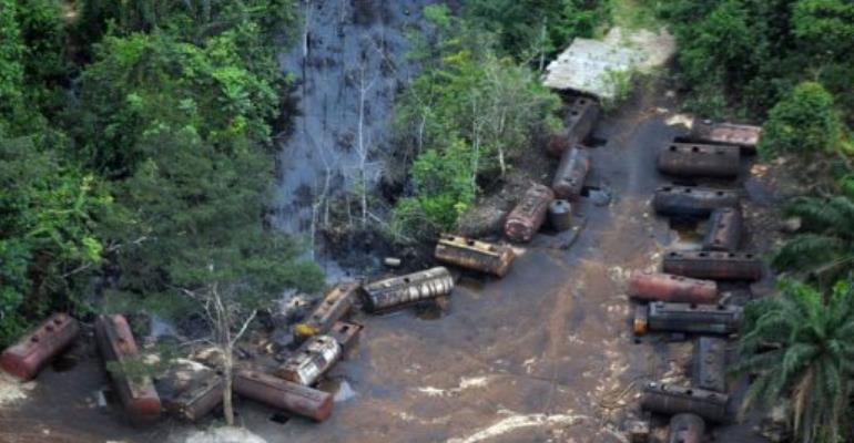 A file picture taken on October 21, 2011 shows Barges laden with stolen oil stationed along the Imo Rivers in Abia state.  By Pius Utomi Ekpei (AFP/File)