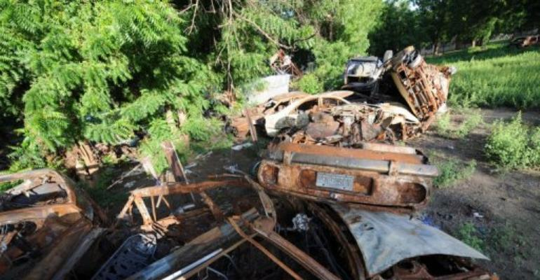 Cars of members of the Islamic sect Boko Haram burnt by the police and military.  By Pius Utomi Ekpei (AFP/File)