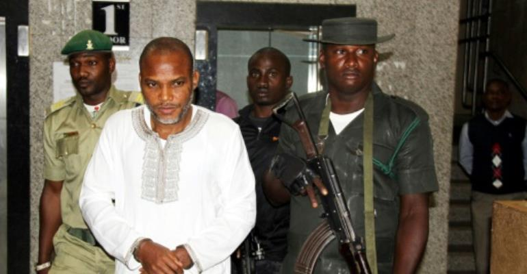 Nnamdi Kanu (C), the head of the Indigenous People of Biafra movement, has been charged with several offences inclucing terrorism-related ones.  By Pius Utomi Ekpei (AFP/File)