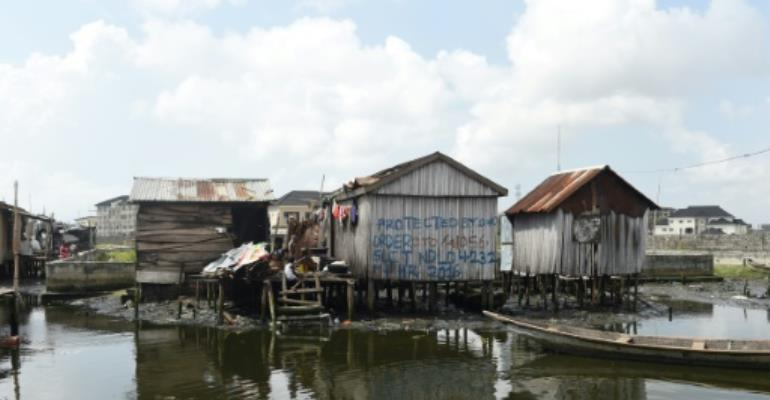 Otodo Gbame, a fishing community in Lagos is the latest casualty in a drive by the authorities to turn Nigeria's commercial capital into a megacity.  By PIUS UTOMI EKPEI (AFP/File)